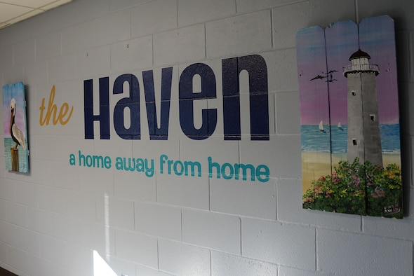 Paintings and a mural are displayed on the wall of the Haven during the Haven reopening Dec. 21, 2017, on Keesler Air Force Base, Mississippi. The Keesler Five-Six Council helped repaint the Haven and bought decorations to improve the dorm common area for Keesler's dorm residents. (U.S. Air Force photo by Airman 1st Class Suzanna Plotnikov)