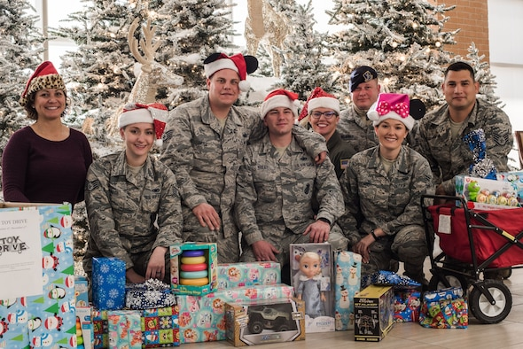 Volunteer Junior Enlisted Council Airmen from Will Rogers Air National Guard Base, Okla., pose with gifts ready to be delivered to children at INTEGRIS Baptist Health Center, Oklahoma City, Dec. 15, 2017. Pictured (from left to right) are Master Sgt. Nongh Lee Kastor, Staff Sgt. Jaimie Haase, Staff Sgt. Kyle Drake, Staff Sgt. Jared Tooley, Staff Sgt, Sarah Bell, Tech. Sgt. Ryan DeLarber, Airman 1st Class Brooke Evans and Staff Sgt. David Carrillo. The JEC collected toys in the months leading up to December and distributed them to families who would be at the hospital over the holidays. (U.S. Air National Guard photo by Senior Airman Brigette Waltermire/Released)