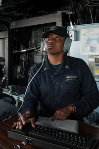 Quartermaster 3rd Class Anastasia Clark, a native of Lake Charles, La., assigned to the amphibious assault ship USS America (LHA 6), stands watch as the detail plotter in the bridge during the ship's departure from Singapore after a scheduled port visit. America, part of the America Amphibious Ready Group, with embarked 15th Marine Expeditionary Unit, is operating in the Indo-Asia Pacific region to strengthen partnerships and serve as a ready-response force for any type of contingency.