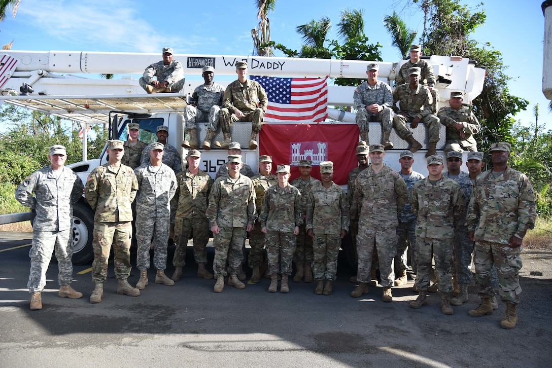 Delta Company, 249th Engineer Battalion Soldiers pose for a group photo USACE South Atlantic Division Commander Brig. Gen. Diana Holland and Task Force Power Restoration Command Col. John Lloyd after an award ceremony highlighting the unit's successful mission during hurricane recovery operations in Puerto Rico.