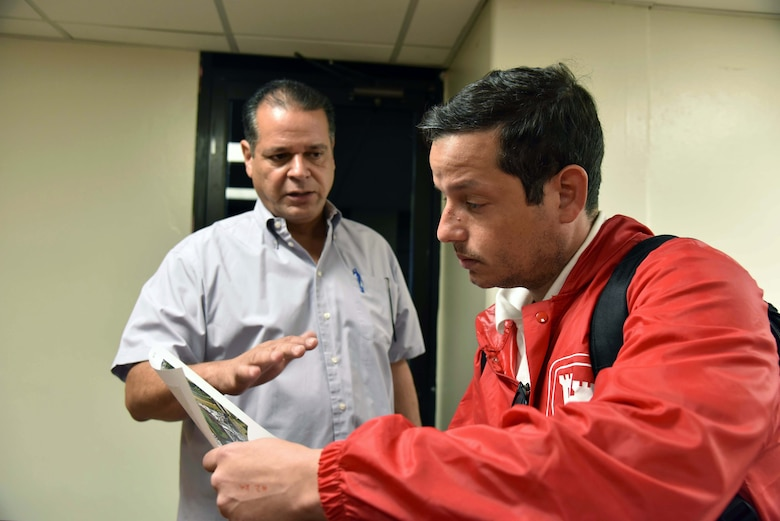 Bayamon Vice Mayor Rurico Pintado Cruz and U.S. Army Corps of Engineers Task Force Power Restoration Real Estate Chief Eric Sternberg discuss the location of potential city land space at the sports complex in Bayamon, Puerto Rico, Dec. 22. The task force sought property for the storage of critical materials used in the power restoration mission, including utility poles and other power grid supplies. The city is allowing the Corps use of its property and infrastructure to help expedite delivery of needed power grid supplies and equipment across the island.