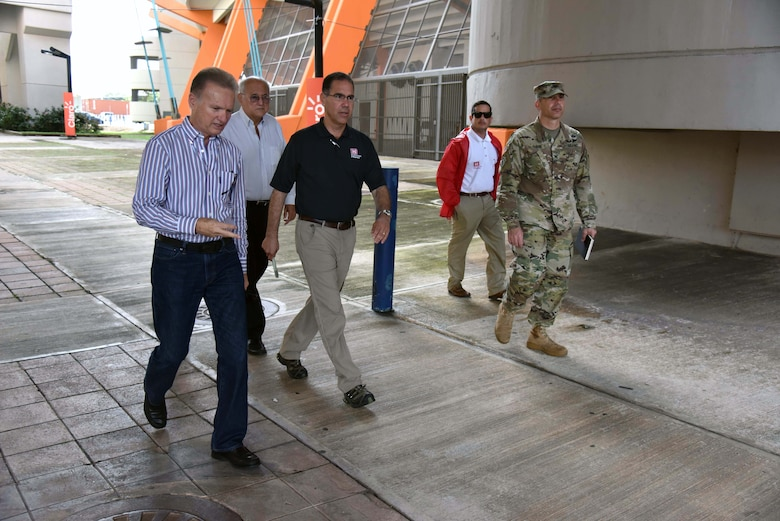 Bayamon City Mayor Ramon L. Rivera Cruz, Attorney Eliezer Aldarondo Ortiz, USACE Puerto Rico Power Grid Program Director Jose Sanchez, Task Force Power Restoration Real Estate Chief Eric Sternberg and TFPR Commander Col. John Lloyd meet Dec. 22 in Bayamon, Puerto Rico, to discuss use of city land space at the Bayamon sports complex for storage of critical materials used in the power restoration mission, including utility poles and other power grid supplies. The city is allowing the Corps use of its property and infrastructure to help expedite delivery of needed power grid supplies and equipment across the island.
