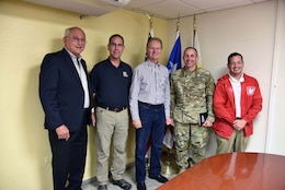 Attorney Eliezer Aldarondo, USACE Puerto Rico Power Grid Program Director Jose Sanchez, Bayamon City Mayor Ramon L. Rivera Cruz, Task Force Power Restoration Commander Col. John Lloyd and Real Estate Chief Eric Sternberg meet Dec. 22 in Bayamon, Puerto Rico, to discuss use of city land space at the Bayamon sports complex for storage of critical materials used in the power restoration mission, including utility poles and other power grid supplies. The city is allowing the Corps use of its property and infrastructure to help expedite delivery of needed power grid supplies and equipment across the island.