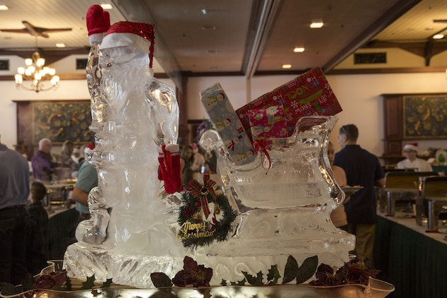An ice sculpture of Santa is displayed at the entrance of the Santa Brunch Dec. 24 at the Butler Officers' Club aboard Camp Foster, Okinawa, Japan. The event brought military families together for an afternoon of enjoyable food and drinks. Children had a last minute chance to sit on Santa's lap for a photo and tell him what they wanted for Christmas. (U.S. Marine Corps photo by Pvt. Nicole Rogge)
