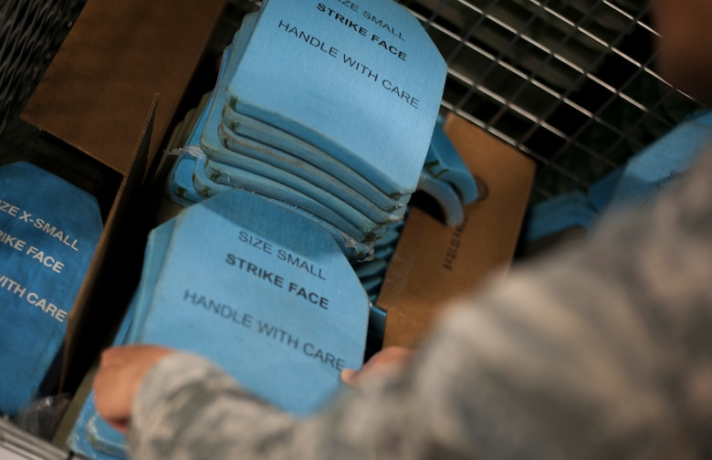 U.S. Air Force Airman 1st Class Gantuya Larkins, an individual protective equipment (IPE) technician assigned to the 6th Logistics Readiness Squadron, performs an inventory check on vest plates at MacDill Air Force Base, Fla., Dec. 28, 2017.