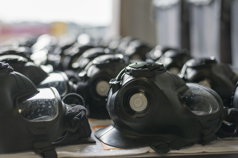M50 gas masks sit on a table after inspection at MacDill Air Force Base, Fla., Dec. 28, 2017