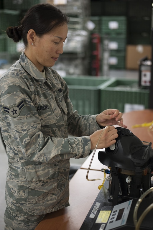 U.S. Air Force Airman 1st Class Gantuya Larkins, an individual protective equipment (IPE) technician assigned to the 6th Logistics Readiness Squadron, checks the seal on an M50 gas mask at MacDill Air Force Base, Fla., Dec. 28, 2017.