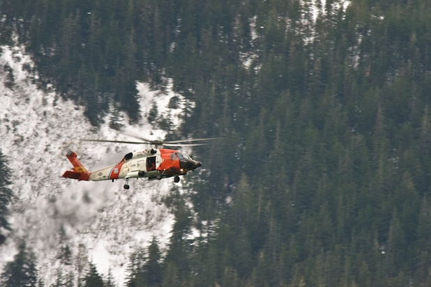Image of Coast Guard helicopter performing search mission in Alaska