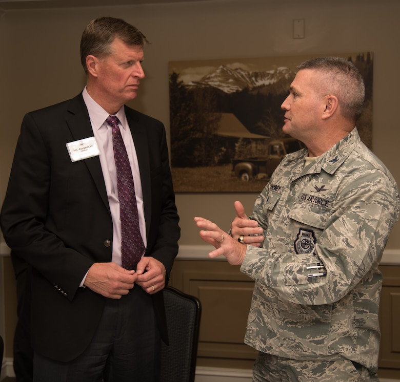 Colonel Eric Dorminey, 21st Space Wing vice commander, meets with Mike Jorgensen, a civilian member of the Area Chiefs of Staff, on Peterson AFB, Colorado Dec. 20 2017. The members of ACOS meet monthly to discuss relevant developments in the local area. (U.S. Air Force photo by 2nd Lt. Justin Davidson-Beebe)