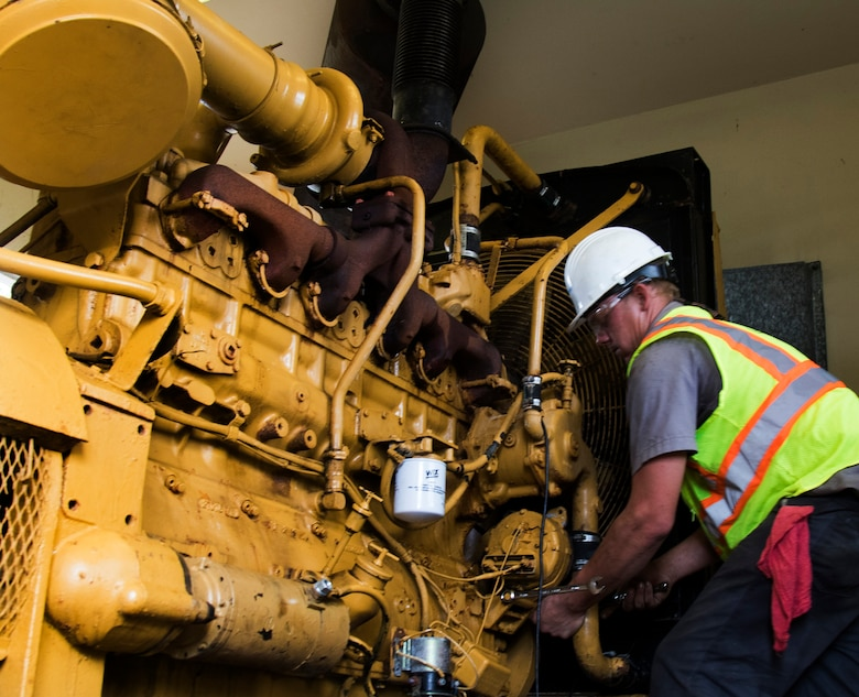 Cody Mercer, a government contractor mechanic, works on repairing a generator that powers a flood control pump near San Juan, Puerto Rico Dec. 27. The repairs are part of the U.S. Army Corps of Engineers' Non-Federal Generator Operation and Maintenance mission in support of FEMA's Hurricane Maria recovery efforts.