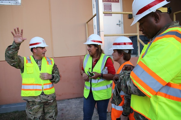 army colonel explains power plant to engineers