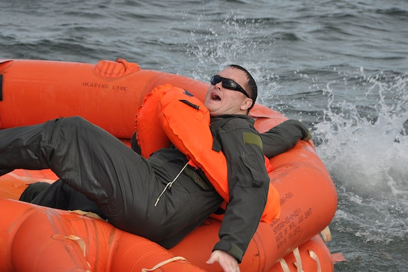 A member of the 94th Operations Group grabs onto a life raft during combat and water survival training at Naval Air Station Key West, Florida Feb. 23, 2017. According to Col. Patrick Campbell, 94th Operations Group commander, this marks the first time this training has completed by aircrew, aeromedical and aircrew flight equipment personnel at the same time.