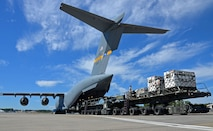 Reserve Citizen Airmen of the 94th Airlift Wing and other Air Force Reserve units load generators onto a C-17 Globemaster III at Dobbins Air Reserve Base, Ga., Oct. 1, 2017. Air Force and FEMA contracted aircraft arrived at Dobbins to pick up medical equipment and relief supplies, to include communication assets. (U.S. Air Force photo by TSgt. Kelly Goonan)