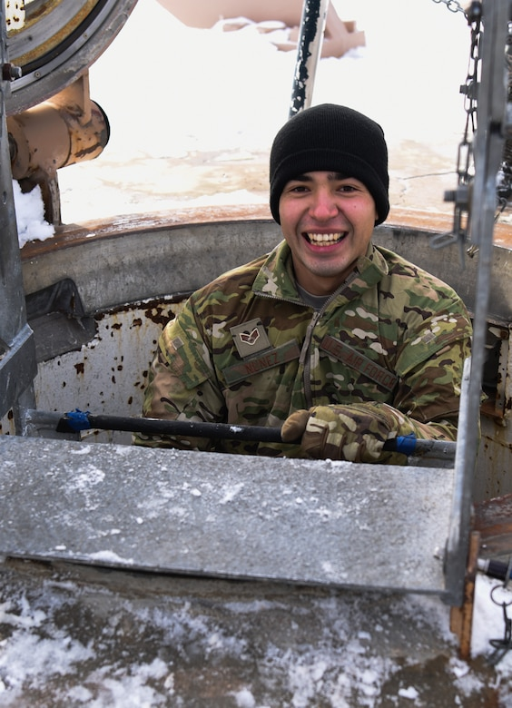 Senior Airman Dereck Nunez, 90th Missile Security Forces flight security controller, smiles for the camera while descending a ladder in the F.E. Warren Air Force Base missile complex, Dec. 28, 2017. Members of the 90th Missile Security Forces Squadron got the chance to go into a missile launch facility to see what they protect every day.