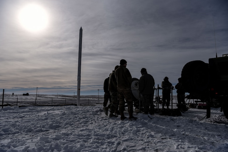 A group of 90th Missile Security Forces defenders wait for the 'all clear' indication before going down into a missile launch facility in the F.E. Warren Air Force Base missile complex, Dec. 28, 2017. Members of the 90th Missile Security Forces Squadron got the chance to go into a missile launch facility to see what they protect every day.