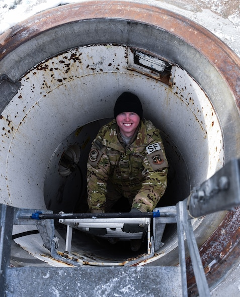 Senior Airman Joseph Targos, 90th Missile Security Forces response force leader, smiles for the camera while descending a ladder in the F.E. Warren Air Force Base missile complex, Dec. 28, 2017. Members of the 90th Missile Security Forces Squadron got the chance to go into a missile launch facility to see what they protect every day.