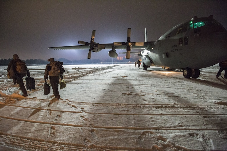 U.S. Air Force Reserve Citizen Airmen with the 514th Aeromedical Evacuation Squadron from Joint Base McGuire-Dix-Lakenhurst, New Jersey, board a C-130H Hercules prior to an aeromedical evacuation training mission, Dec. 15, 2017. During this training mission, the ground was covered with about five inches of icy slick snow, demonstrating the C-130's ability to operate in challenging conditions, and allowing for safe and rapid patient evacuation in a variety of environments. (U.S. Air Force photo by Master Sgt. Mark C. Olsen)
