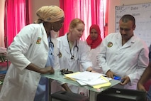 Maj. Brandi Faudree (second from left), a physician assistant with the Kentucky Air National Guard's 123rd Medical Group in Louisville, Ky., reads electrocardiograms with cardiologists and emergency department physicians at Omar Hassan A. Al Bashir Hospital in Djibouti City, Djibouti, March 11, 2017. Faudree was one of three members of the Kentucky National Guard military medical engagement team that visited the hospital in support of the Kentucky State Partnership Program.