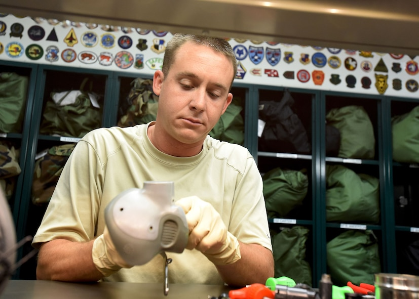 Master Sgt. David Clark, an aircrew flight equipment journeyman with the Kentucky Air Guard's 123rd Operations Support Squadron in Louisville, Ky., performs routine inspection and maintenance of pilot headgear to ensure its integrity June 9, 2017. Every helmet and attachments are carefully cleaned, repaired, and tested by members of the aircrew flight equipment shop.