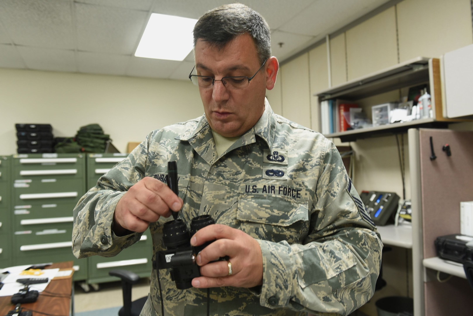 Master Sgt. Delbert Brumbaugh, an aircrew flight equipment journeyman with the Kentucky Air Guard's 123rd Operations Support Squadron in Louisville, Ky., cleans the lenses of night-vision goggles in preparation for aircrew use June 9, 2017. Regular maintenance and inspection of life-saving equipment is the mission of the aircrew flight equipment shop.