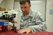 After identifying a weak area on an aircraft seat harness, Tech. Sgt. Lawrence Lawfer, an aircrew flight equipment journeyman with the Kentucky Air Guard's 123rd Operations Support Squadron in Louisville, Ky., uses an industrial sewing machine to repair it June 9, 2017. Members of the aircrew flight equipment shop here are skilled in many different repair techniques