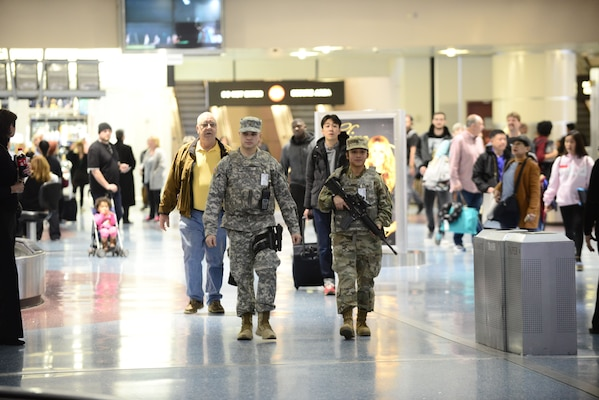 Two Nevada National Guard Soldiers conduct a foot patrol through the McCarran International Airport baggage claim in Las Vegas, Nevada.