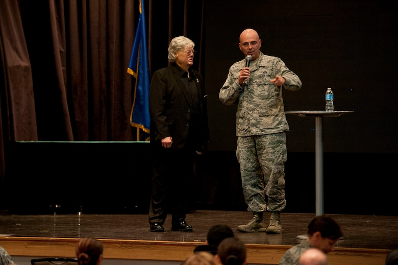 U.S. Air Force Chief Master Sgt. Alexander Del Valle, 51st Fighter Wing command chief, thanks Dave Roever, a Vietnam War veteran, for speaking about resiliency at Osan Air Base, Republic of Korea, Jan. 25, 2017. Roever, is an inspirational speaker who shares his story about how he survived after suffering burns all over his body when a phosphorus grenade exploded in his hand during the war. (U.S. Air Force photo by Staff Sgt. Jonathan Steffen)