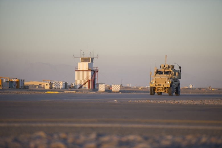 A Mine Resistant Ambush Protected vehicle, driven by a member of the 451st Expeditionary Support Squadron Security Forces Flight, patrols the flight line at Kandahar Airfield, Afghanistan, Jan. 20, 2016. The U.S. Air Forces Central Command Force Protection directorate at the Combined Air Operations Center at Al Udeid Air Base, Qatar, acts as the nexus of security operations across the area of responsibility to ensure security forces personnel can protect personnel, assets and, ultimately, the mission. (U.S. Air Force photo/Tech. Sgt. Robert Cloys)