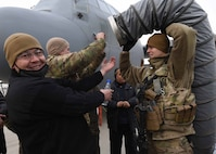 Tech. Sgt. Chad Conroy, 440th Air Expeditionary Advisory Squadron, C-130 maintenance advisor, a reservist assigned to Youngstown Air Reserve Station, Ohio, provides heat for Afghan Air Force maintainers before training at Kabul Air Wing, Afghanistan, Jan. 18, 2017. The AAF received four C-130H models at the beginning of 2014. On Jan. 11, 2017, a group of 44 AAF C-130H maintainers were the first in-country trained to graduate and receive their level three certification. (U.S. Air Force photo by Tech. Sgt. Veronica Pierce)