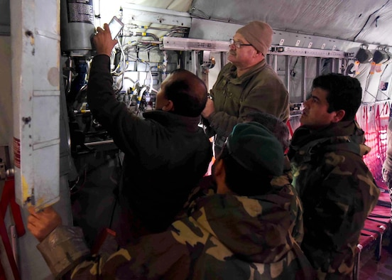 Master Sgt. Steven Ashley, 440th Air Expeditionary Advisory Squadron, C-130 maintenance advisor, assigned to Dobbins Air Reserve Base, Ga., trains Afghan Air Force maintainers on interior systems in a C-130H at Kabul Air Wing, Afghanistan, Jan. 18, 2017. On Jan. 11, 2017, a group of 44 AAF C-130H maintainers were the first in-country trained to graduate and receive their level three certification.   The recent graduates were trained by Total Force Airmen who specialize in various maintenance Air Force Specialty Codes from; engine and propulsion, hydraulics, fuel, electrical and environmental, avionics, and crew chief specialist. (U.S. Air Force photo by Tech. Sgt. Veronica Pierce)