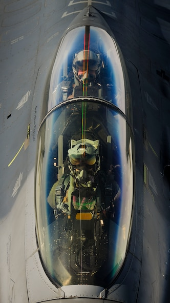 An F-16 Fighting Falcon pilot and crew member from Aviano Air Base, Italy, wait while their F-16 receives fuel from a KC-135 Stratotanker, assigned to the Arizona Air National Guard's 161st Air Refueling Wing, Jan. 27, 2017, at Souda Bay, Greece. The KC-135 refueled U.S. and Hellenic air force F-16s during the FTD, which was hosted to evaluate aircraft and personnel capabilities and increase interoperability between the two NATO allies. (U.S. Air Force photo by Staff Sgt. Austin Harvill)