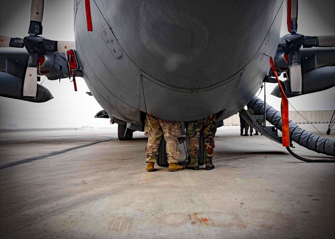 A C-130H maintenance advisor from Train, Advise, Assist Command-Air (TAAC-Air), 440th Air Expeditionary Advisory Squadron, trains an Afghan Air Force C-130 maintainer on the aircraft hydraulics  system at Kabul Air Wing, Afghanistan, Jan. 18, 2017. On Jan. 11, 2017, a group of 44 AAF C-130H maintainers were the first in-country trained to graduate and receive their level three certification.    The recent graduates were trained by Total Force Airmen who specialize in various maintenance Air Force Specialty Codes from; engine and propulsion, hydraulics, fuel, electrical and environmental, avionics, and crew chief specialist. (U.S. Air Force photo by Tech. Sgt. Veronica Pierce)