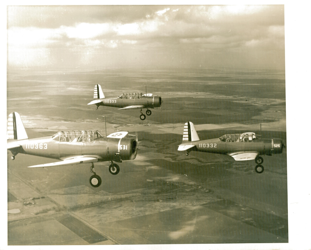 A group of BT-13 Valiants from Vance Air Force Base, Okla. soar over Northwest Oklahoma in the early 1940s. The BT-13 Valiant served almost exclusively as the basic trainer for all aircrews trained in the U.S. during World War II. By 1945, the aircraft was being replaced with other advanced models and after the war the aircraft was retired. (Courtesy Photo)