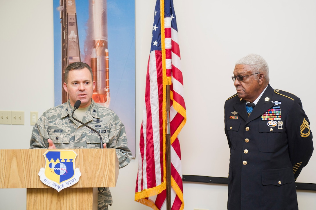 Vice Wing Commander Col. Walt Jackim introduces retired U.S. Army Sgt. 1st Class Melvin Morris, Medal of Honor recipient, to Patrick Air Force Base Airmen Jan. 31, 2017. Jackim reminded the audience that every service member raises their right hand to support the same oath and will possibly one day be called on to make a crucial decision rooted in one's character. (U.S. Air Force photo by Phil Sunkel)