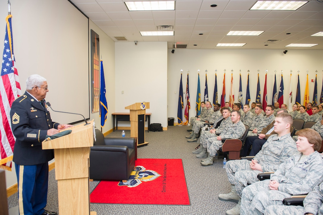 Medal of Honor recipient retired U.S. Army Sgt. 1st Class Melvin Morris speaks to members of Patrick Air Force Base, Fla. Jan. 31, 2017. Morris emphasized the importance of pushing through adversity because we are trained and trusted to always get the job done regardless of our circumstances. (U.S. Air Force photo by Phil Sunkel)