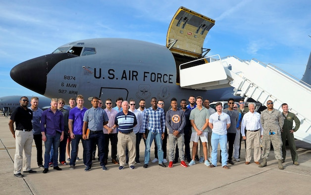 Members of Team MacDill and the Tampa Bay Rays baseball organization pause for a photo during a base tour at MacDill Air Force Base, Fla., Jan. 18, 2017. Each year the Rays team organizes a tour to gives its minor league players a glimpse into how Team MacDill carries out its mission. (U.S. Air Force photo by Airman 1st Class Heather Fejerang)
