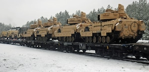 M1A2 Abrams tanks loaded onto railcars in Trzbien, Poland, wait to be transported to Estonia, Jan. 31, 2017. The tanks are assigned the 4th Infantry Division's Charlie Company, 1st Battalion, 68th Armored Regiment, 3rd Armored Brigade Combat Team, which is starting a rotation to Estonia in support of Operation Atlantic Resolve. Army photo by Staff Sgt. Corinna Baltos