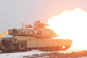 An Army M1A2 Abrams tank fires a round during the first live-fire accuracy screening tests at Presidential Range in Swietozow, Poland, Jan. 16, 2017. The tank and crew are assigned to the 4th Infantry Division's 1st Battalion, 68th Armor Regiment, 3rd Armored Brigade Combat Team. Army photo by Staff Sgt. Elizabeth Tarr