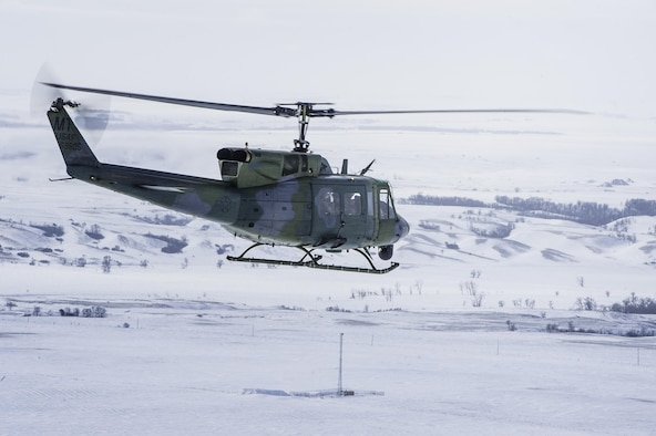 A UH-1N Iroquois from the 54th Helicopter Squadron flies over Minot Air Force Base's missile complex, N.D., Jan. 25, 2017. The purpose of the flight was to perform training maneuvers and complete a security sweep of 91st Missile Wing launch facilities.  The 54th HS's fleet is critical in providing support to 91st MW Airmen and assets in the missile complex. (U.S. Air Force photo/Airman 1st Class J.T. Armstrong)