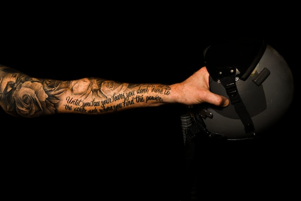 Maj. Matthew, 432nd Wing/432nd Air Expeditionary Wing Commander's Action Group chief, displays his tattoos Jan. 26, 2017, at Creech Air Force Base, Nev. The roses on his arm represents natural beauty and the quote 'Until you face your fears, you don't move to the other side, where you find the power' references a book about the Ironman Triathlon and is key to keeping him motivated during his own training. An updated tattoo policy has taken effect as of Feb. 1, 2017, and is key to the recruitment of the nation's top talent. (U.S. Air Force photo by Airman 1st Class James Thompson)