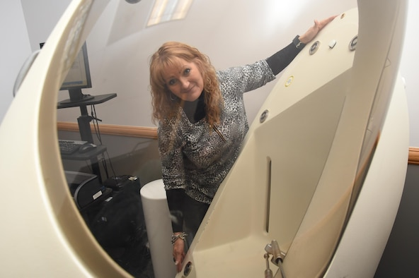 Peggy Diaz De Leon, new health and fitness coordinator, Health and Wellness Center, explains the BodPod, a machine used to determine one's body fat percentage, at Schriever Air Force Base, Colorado, Wednesday, Jan. 17, 2017. The BodPod is a machine capable of detecting body fat compositions, no matter how slight. To be tested, individuals sit quietly inside the machine for three minutes. (U.S. Air Force photo/Airman William Tracy)