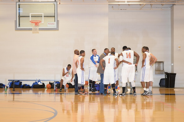 The McConnell Tornadoes huddle during half-time of a game with the Tinker Hawks, Oct. 17, 2015, at McConnell Air Force Base, Kan. The team focuses on communication to be effective on the court and while performing the mission as Airmen. (U.S. Air Force photo/Senior Airman Colby L. Hardin)