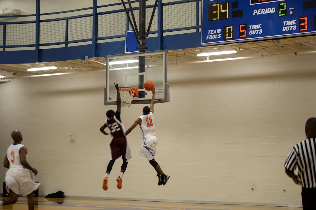 Lt. Ramoane Jordan, McConnell Tornadoes basketball player, executes a lay-up during a game against the Tinker Hawks, Oct. 17, 2015, at McConnell Air Force Base, Kan. The team represents the base by duking it out against 15 other Air Force and Army installation basketball teams from Texas, Louisiana, Oklahoma, Colorado, New Mexico and Missouri. (U.S. Air Force photo/Senior Airman Colby L. Hardin)