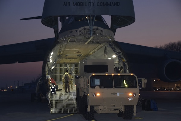 A heavy expanded mobility tactical truck pulls an electrical power plant system from the belly of a C-5 Super Galaxy at Osan Air Base, Jan. 26, 2017.  The addition of the inbound Patriot equipment will support 35th ADA Brigade as it conducts the largest Patriot modernization effort ever executed outside a depot facility.