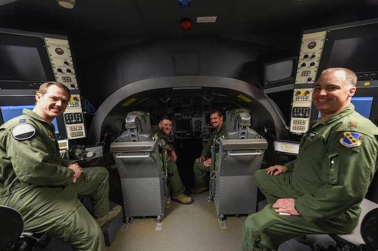 U.S. Air Force B-1B Lancer weapon system operators Object (left), Count, Snare and Pyle sit together in a B-1 weapon simulator at Dyess Air Force Base, Texas, Jan. 25, 2017. WSOs work directly with programs and equipment that allow them to mark targets, make adjustments to the path a bomb will take and release the munition. (U.S. Air Force photo by Airman 1st Class Quay Drawdy)