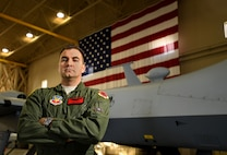 Capt. James, 432nd Wing/432nd Air Expeditionary Wing MQ-9 Reaper and MQ-1 Predator instructor pilot, stands in front of an MQ-9 Jan. 31, 2017, at Creech Air Force Base, Nev. On Aug. 11, 2016, James was off duty when he responded to a vehicular accident by taking initial control of the accident site and administering critical first aid, saving three lives. (U.S. Air Force photo by Airman 1st Class James Thompson)
