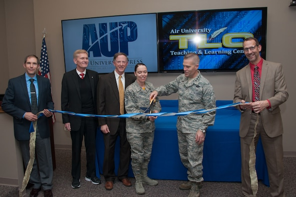 Lt. Gen. Steven Kwast, Commander and President of Air University, and Air University Command Chief, Chief Master Sgt. Juliet Gudgel officially open AU's Teaching and Learning Center and the re-opening of Air Univeristy Press Jan. 27, 2017, at Maxwell Air Force Base, Ala. The center is a place where people can come together and explore new technologies, share ideas, and experiment with techniques and apply them in ways that are meaningful to AU. Accompanying Kwast and Gudgel, from left to right, are Dr. Shane Duncanson, TLC Writing Lab Specialist, Dr. Dale Hayden, Air University Press Director, Dr. Anthony Gould, TLC Director and Mr. Douglas McCarty, TLC Instructional System Specialist. (US Air Force photo/Bud Hancock)
