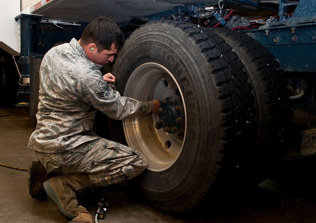 Senior Airman Francisco Perez, 91st Missile Maintenance Squadron missile handling team technician, inspects tire lugs on a transporter erector at Minot Air Force Base, N.D., Jan. 19, 2017. The MHT oversees the shipping and receiving of nuclear capable Minuteman missiles and is responsible for transporting them to-and-from a launch facility. (U.S. Air Force photo/Airman 1st Class Jonathan McElderry)