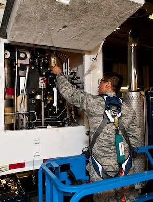 Senior Airman Jesse Casper, 91st Missile Maintenance Squadron missile handling team technician, inspects a hoist control box at Minot Air Force Base, N.D., Jan. 19, 2017. The MHT oversees the shipping and receiving of nuclear capable Minuteman missiles and is responsible for transporting them to-and-from a launch facility. (U.S. Air Force photo/Airman 1st Class Jonathan McElderry)