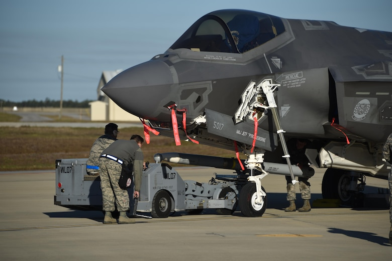 A U.S. Air Force weapons load crew assigned to the 33rd Aircraft Maintenance Squadron loads a live AIM-120 advanced medium-range air-to-air missiles (AMRAAM) into an F-35A January 31, 2017, at Eglin Air Force Base, Florida. The 33rd Fighter Wing loaded and shot the first air-to-air missiles from an F-35A during a weapons system evaluation that took place at Tyndall Air Force Base later the same day. Carrying air-to-air missiles makes the F-35 a more versatile option for combatant commanders by securing the aircrafts survivability, in turn increasing likeliness of mission success.  (U.S. Air Force photo by Staff Sgt. Peter Thompson)